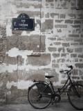 Bicycle and Street Sign, Paris, France Stampa fotografica di Jon Arnold