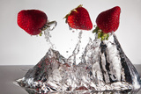 Three Stawberries FreshSplash Photographic Print by Steve Gadomski