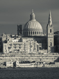 Malta, Valletta, Skyline with St; Paul's Anglican Cathedral and Carmelite Church from Sliema Photographic Print by Walter Bibikow