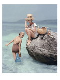 Vogue - January 1957 - Picnic Rock Photographic Print by Richard Rutledge