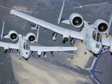 Two A-10C Thunderbolt II Aircraft Fly in Formation Photographic Print by  Stocktrek Images
