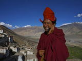 The Head Abbot Holds a Cell Phone at the Karsha Monastery Reproduction photographique par Steve Winter