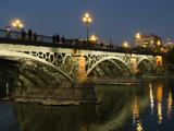 The Bridge of Triana, Puente De Triana, Illuminated at Night Fotografisk trykk av Krista Rossow