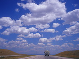 Clouds in a Vast Sky Above a Highway in Montana Photographic Print by Aaron Huey
