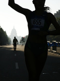 A Silhouetted Competitor Completes the 5K Lung Cancer Benefit Run Photographic Print by AJ Wilhelm