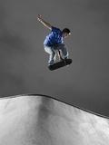 Skateboarder Performing Tricks Photographic Print