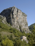 Rock of Castellane Towering Above a Small House Photographic Print by Chris Hellier