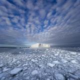 Blue Tabular Iceberg Sculpted by Waves Stampa fotografica di John Eastcott & Yva Momatiuk