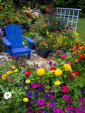 Backyard Flower Garden With Chair Photographic Print by Darrell Gulin