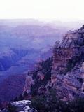 Sunset paints the Grand Canyon purple and mauve Photographic Print by Elliott Kaufman