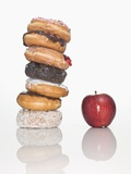 Stack of Donuts and One Apple Valokuvavedos