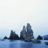 Dramatically Shaped Sea Stacks in Ocean Photographic Print by Micha Pawlitzki