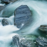 Rushing water and rocks on South Island, New Zealand Photographic Print by Micha Pawlitzki