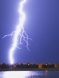 Lightning Striking an Apartment Complex Photographic Print by Jim Reed