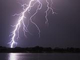 Lightning Striking Ground Near Residential Lake Photographic Print by Jim Reed