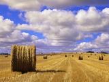 Bales and Clouds Near Sherbrooke, Saskatchewan, Canada. Premium fotografisk trykk av Mike Grandmaison