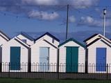 Beach Huts on Devon Town's Waterfront Photographic Print by Kim Sayer