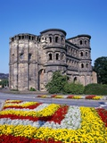Flower Beds in Front of Porta Nigra in Trier Photographic Print by Richard Klune