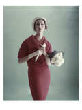 Vogue - February 1959 - Woman with Bouquet of Carnations Photographic Print by Karen Radkai