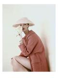 Vogue - March 1956 - Model Evelyn Tripp wearing pink ensemble Photographic Print by Karen Radkai