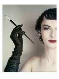 Vogue - October 1952 - Woman with Cigarette Holder Photographic Print by Erwin Blumenfeld