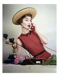 Vogue - April 1953 - Juggling Phone Calls Photographic Print by Erwin Blumenfeld
