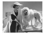 Vogue - July 1934 - Isabel Johnson Sitting with Poodle Premium Photographic Print by Edward Steichen