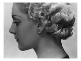 Vogue - February 1934 - Blonde Woman Wearing Spiral Clip Earrings Premium Photographic Print by George Hoyningen-Huené