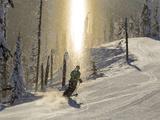 Skiing Through a Sundog on Corduroy Groomed Runs at Whitefish Mountain Resort, Montana, Usa Fotografisk tryk af Chuck Haney