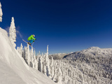 Jumping from Cliff on a Sunny Day at Whitefish Mountain Resort, Montana, Usa Fotografisk tryk af Chuck Haney