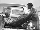 Actor Steve McQueen and Stuntman Bud Ekins During the Mojave Desert Motorcycle Race, May 1963 Premium fotografisk trykk av John Dominis