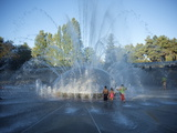 Children Play in the Fountain at Seattle Center, Seattle, Washington State, USA Photographic Print by Aaron McCoy