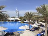 Burj Al Arab Seen From the Swimming Pool of the Madinat Jumeirah Hotel, Jumeirah Beach, Dubai, Uae Photographic Print by Amanda Hall