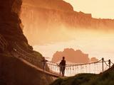 Crossing Carrick-A-Rede Rope Bridge on the North Antrim Coast Fotografie-Druck von Chris Hill