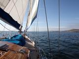 Yacht Sailing West Along the Coast, Dorset, England, United Kingdom, Europe Photographic Print by David Lomax
