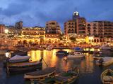 Evening across Spinola Bay with Restaurants, St. Julian`S, Malta, Mediterranean, Europe Fotografie-Druck von Stuart Black
