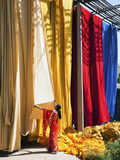 Woman in Sari Checking the Quality of Freshly Dyed Fabric Hanging to Dry, Sari Garment Factory, Raj 写真プリント : ギャビン・ヘラー