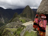 Traditionally Dressed Children Looking over the Ruins of Machu Picchu, UNESCO World Heritage Site,  Photographic Print by Simon Montgomery