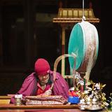 India, Ladakh, Hemis, Monk Reciting Prayers to the Slow Rhythm of a Drum at Hemis Monastery Photographic Print by Katie Garrod