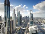 Skyscrapers Along Sheikh Zayed Road Looking Towards the Burj Kalifa, Dubai, United Arab Emirates Fotoprint av Gavin Hellier