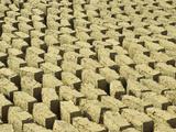Mud Bricks Drying in the Sun, Mali Fotografisk trykk av Gary Cook