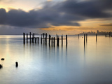 San Francisco and San Francisco Bay at Sunrise, with Old Pier Pilings under Cloudy Skies Photographic Print by Patrick Smith