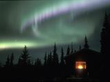 Aurora Borealis on a Cold Winter Night over a Cabin in the Taiga, Alaska, USA Reproduction photographique par Tom Walker