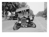 Automobile's Front Axel Breaks Splaying Tires Outward Causing Vehicle to Rest on its Front Bumper. Kunstdrucke