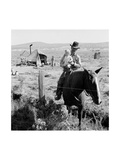 Cowboy Holds His Baby While Riding a Horse Plakater af Dorothea Lange