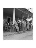 Suiting Up for Baseball at the Gasoline Station Plakat af Dorothea Lange