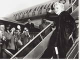 Marilyn Monroe Boards Airplane, New York, c.1956 Stretched Canvas Print