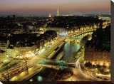 Overlooking Paris at Night Stretched Canvas Print by Michel Setboun