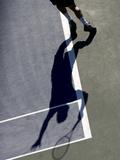 Shadow of Tennis Player Serving Lámina fotográfica