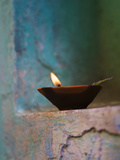 Lamp in a Little Shrine Outside Traditional House, Varanasi, India Fotografie-Druck von Keren Su